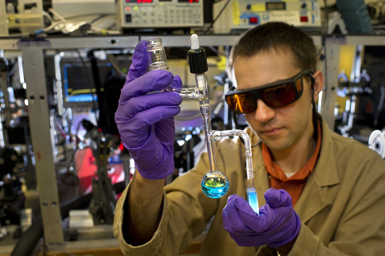 DOE Photo: Brookhaven National Laboratory scientist examining a vial containing a specialized catalyst designed to help convert solar energy into fuel